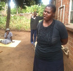 Mrs Gladys Cleopas with two of her mentally challenged children on the background (far right).