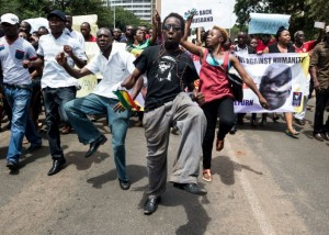Protesters march to mark the one-year anniversary of the disappearance of Zimbabwean activist Itai Dzamara in Harare, March 9. Dzamara was abducted in March 2015 and his family believes the state may have played a role in him going missing.
