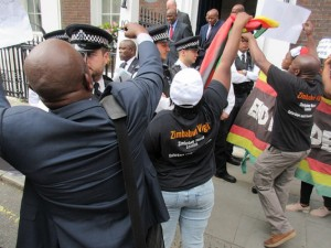 Police protect Chinamasa and friends from Vigil protesters