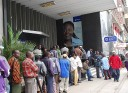 Money shortages means queues to get money out of the banks.
