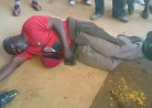 MDC-T man lays on the ground, beaten by 'police'