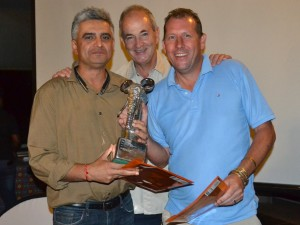 VFAPU Golf Day winners Sanjay Babbar (left) and Tom Austin (right) receive their trophy and prizes from Africa Albida Tourism chief executive Ross Kennedy (centre).