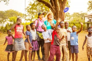 Children from Rose of Charity Orphanage and the surrounding neighborhood together with WorldVentures Foundation Executive Director Gwyneth Lloyd on the right, and Jennifer Ho on the left.