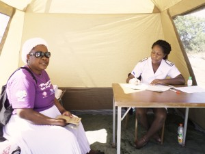 A community nurse attending to a patient at mobile clinic.