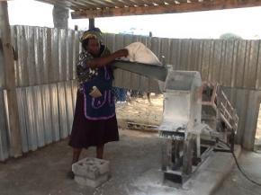 Naomi Gatsheni next to her grinding mill