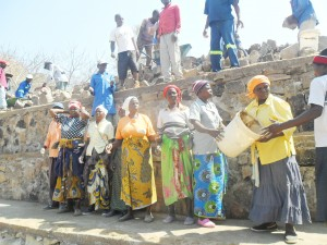 Women taking part in the weir construction.