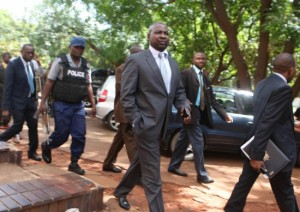 Tables turned ... Prosecutor General Johannes Tomana (centre) taken to court Tuesday