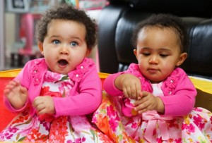 Identical sisters Amelia (right) and Jasmine - who have different skin an eye colour.