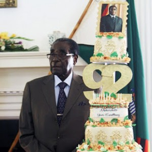 The man and his cake ... President Robert Mugabe at State House on Monday