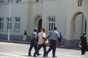 Taken away ... Police arresting Silvanos Mudzvova (Picture by Shepered Tozvireva and NewsDay)