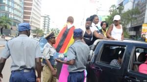 Police in Zimbabwe block protesters demanding the return of women stranded in Kuwait. (Photo: Mavis Gama)