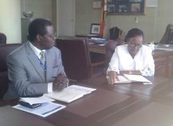 Negotiation table ... UNHCR Rep, Robert Tibagwa and Mupfumira