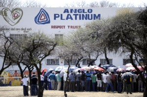 Striking mine workers gather outside the Anglo American Mine on October 5, 2012 in Rustenburg. South African police on October 5 recovered the body of a miner killed in clashes with striking workers at the platinum mine, as President Jacob Zuma appealed for an end to months of often violent industrial disputes. Miners said the man was killed late on October 4 when police used tear gas and rubber bullets to disperse a group of illegal strikers from the mine. Some 28,000 workers have been on a strike at Anglo American Platinum (Amplats), the world's top platinum producer, since September 12, demanding higher wages. AFP PHOTO / STEPHANE DE SAKUTIN        (Photo credit should read STEPHANE DE SAKUTIN/AFP/GettyImages)