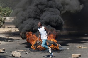 A man in Bulawayo where protesters have clashed with police (Picture: Getty)