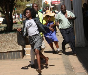 People run for cover in Harare's First Street after police fired teargas and started randomly beating up people in an attempt to crush the peaceful protest