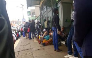 Citizens seen queue for their hard earned money at banks for long hours.