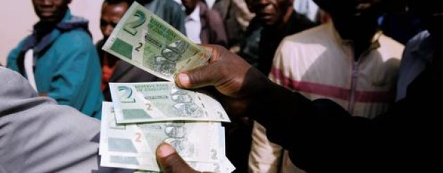 Zimbabwe labours through first week of the return of its bank notes
